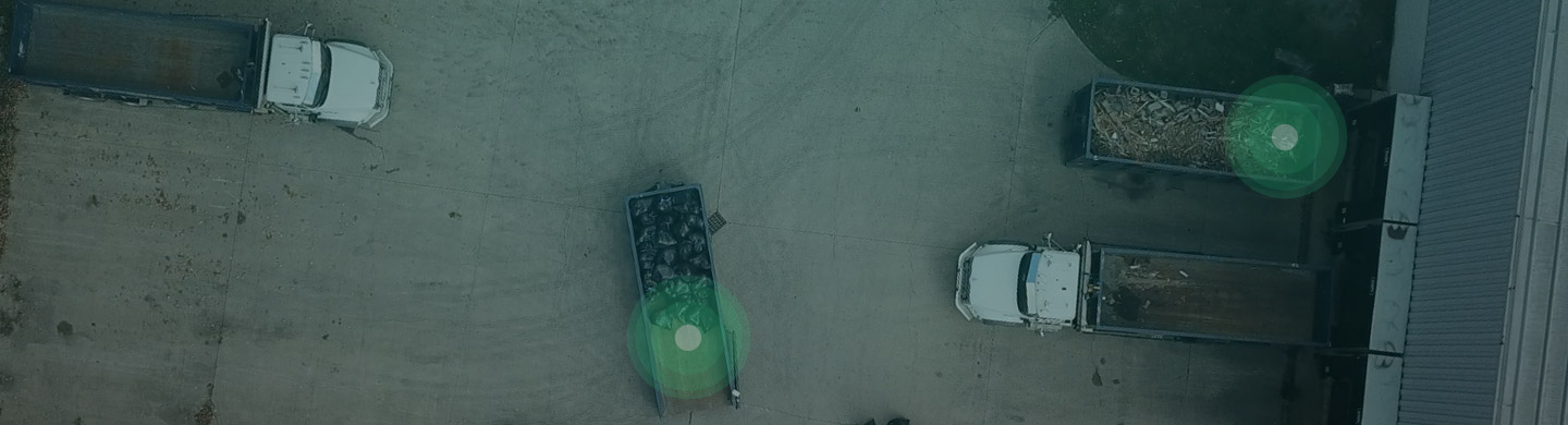 Aerial View of Roll Off Dumpsters and Truck Inventory